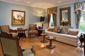 Upstairs Living room reorganized with existing furnishings and ready made draperies and no rug for safety
